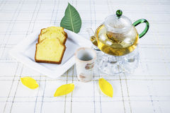 Green Tea and Cake on Table with with flower leafs Royalty Free Stock Image