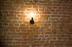 Vintage lamp on old brick wall background stock photography