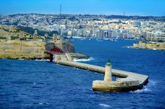 Light house and entering to the port iValletta,Malta. Horizontal photo of Light house and entrance to valleta harbour malta Stock Image