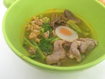 Horizontal photo of noodles on green bowl with pork and vegetabl Stock Photo