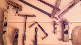 The horizontal photo of the old tools on the wooden wall. Scenery. Antique Decorative Tools royalty free stock photography