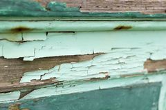 Horizontal photo of old wood with chipped peeling teal paint. Horizontal photo of old wood with rough, chipped, peeling teal paint. Will give your vintage royalty free stock images