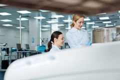 Horizontal photo of positive researchers being in the lab Stock Photography