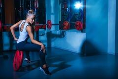 Horizontal photo of pretty sports woman in gym Royalty Free Stock Photo