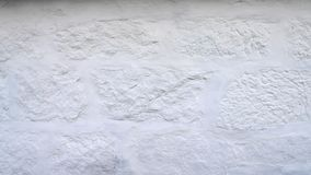 Rustic white wall texture and background. Uneven, imperfect old bricks with brand new coat of whitewash. With copy space. Horizontal photo of rustic white wall stock photo