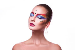 Horizontal photo of sensual adult girl with multicolor make up Royalty Free Stock Images
