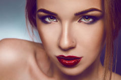 Horizontal photo of serious adult girl with nice make up in stud Stock Images