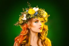 Horizontal photo of sexual girl with wreath on green background Stock Photography