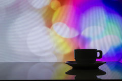 Horizontal photo of silhouette coffee cup on colorful bokeh back Royalty Free Stock Photos