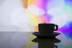 Horizontal photo of silhouette coffee cup on colorful bokeh back Royalty Free Stock Photo