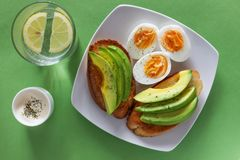 Open sandwiches with avocado and eggs royalty free stock photos