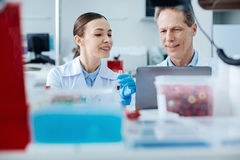Horizontal photo of two technicians while working together Royalty Free Stock Photo