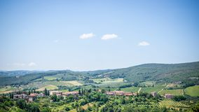 View to country near the town in Tuscany with lot of trees and buildings stock image