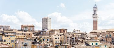 View on the tower of town-hall in italian Siena Stock Photo