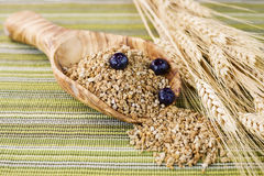 Whole Grain Cereal in Large Wooden Spoon Stock Image