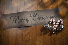 Merry Christmas Sign on Wood Background stock images