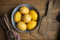 Bowl of Lemons. Horizontal photography of a bowl of lemons on a wood background and vintage props on either side stock photos