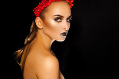 Horizontal picture of sexy young woman with healthy skin and beu. Aitulf makeup on black background in studio Stock Photos
