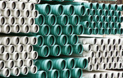 Pipes. Stacks of white and green pipes in the rain Royalty Free Stock Photos