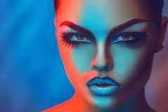 Horizontal portrait of beaty girl with make up in red and blue l Stock Photography