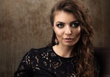 Horizontal portrait of a beautiful young woman in a black lace dress Stock Images