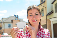 Horizontal portrait of a brunette with a key Royalty Free Stock Image