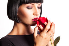Horizontal portrait of brunette with red rose Royalty Free Stock Images