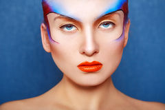 Horizontal portrait of charming woman with creative make up. In studio stock images