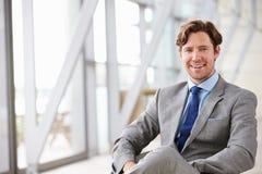 Horizontal portrait of corporate businessman sitting Stock Photo