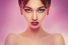 Horizontal portrait of cute female with make up in studio Royalty Free Stock Photography