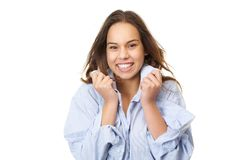 Horizontal portrait of a cute girl giggling. And holding shirt isolated on white background Royalty Free Stock Photography