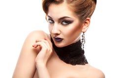 Horizontal portrait of fashion model with make up on white backg Stock Photos
