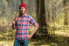 Horizontal portrait of a forester with a beard in the forest. With an ax Stock Photography