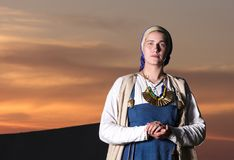 Horizontal portrait in full length of a young woman in historical costume Royalty Free Stock Photography