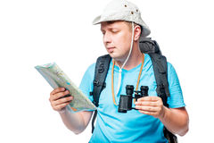 Horizontal portrait of a lost tourist looking at a map Royalty Free Stock Image