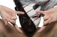 Horizontal portrait with makeup and rock gesture royalty free stock photo