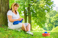 Horizontal portrait of a mature woman on a green lawn Stock Photo