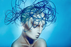 Horizontal portrait of pretty woman with body art on blue backgr Stock Image