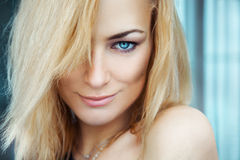 Horizontal portrait of sexy young adult blonde girl with blue ey Royalty Free Stock Photo