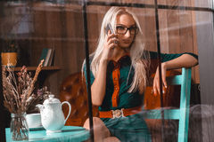 Horizontal portrait of sexy young blonde business woman talking Royalty Free Stock Photography