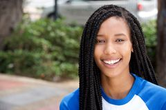 Horizontal portrait of smiling young african american woman outside. Close up horizontal portrait of smiling young african american woman outside stock image