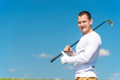 Horizontal portrait of a successful golfer with a golf club stock image
