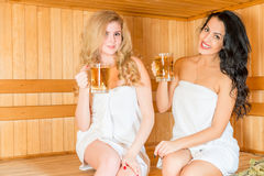 Horizontal portrait of two beautiful girls in the sauna Royalty Free Stock Photography