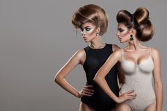 Horizontal portrait of two women with creative hairstyle an. D nice makeup in studio stock photo