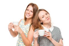 Horizontal portrait of two women with cups of coffee Royalty Free Stock Images