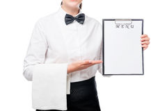 Horizontal portrait of a waitress with menu blank in hands Royalty Free Stock Photo