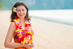 Horizontal portrait of a woman on the beach in floral Hawaiian L. Ei Royalty Free Stock Photo