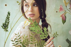 Horizontal portrait of woman behind the screen with dried plants Royalty Free Stock Photos