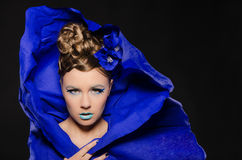 Horizontal portrait of woman in blue Royalty Free Stock Photo