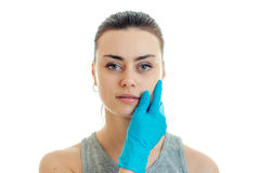 Horizontal portrait of a young girl without makeup at a cosmetologist in a blue glove Stock Images